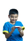 Asian kid smile receive Christmas gift. On white background Stock Images