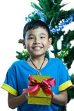 Asian kid smile receive Christmas gift. On white background Stock Photos
