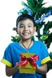 Asian kid smile receive Christmas gift Stock Photos