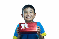 Asian kid smile receive a present. On white background Royalty Free Stock Photo