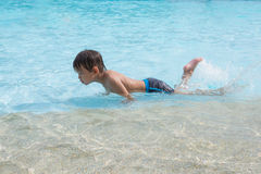 Asian  kid in swimming pool Royalty Free Stock Image