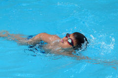 Asian kid swims in swimming pool - front crawl style take deep breath Stock Photos