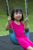 Asian Kid Swing At Park Stock Photo