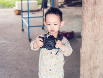 Asian kid take a photo by DSLR camera Royalty Free Stock Photography
