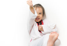 Asian kid is throwing taekwondo kick isolated. On white stock photos