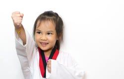 Asian kid is throwing a taekwondo punch Stock Image