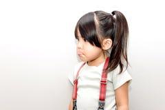 Asian kid unhappy action Stock Photos