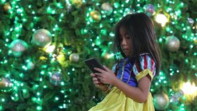 asian kid use mobile to hangout new year party