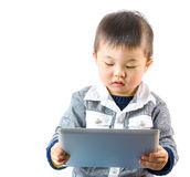 Asian kid using tablet Royalty Free Stock Photography