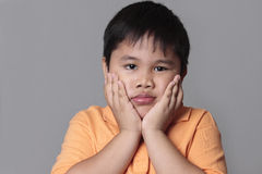 Asian kid very sad Royalty Free Stock Photo