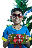 Asian kid wearing sunglass and hold small present box Royalty Free Stock Photography