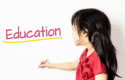 Asian Kid wrote Education on white board. Asian Kid wrote Education on a white board Royalty Free Stock Image