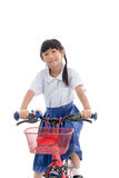 Asian kids cute girl in student's uniform riding Royalty Free Stock Photo
