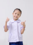 Asian kids cute girl in student's uniform on white background Stock Photo