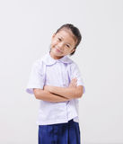 Asian kids cute girl in student's uniform on white background Royalty Free Stock Images
