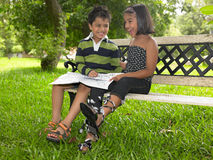 Asian kids excited in the park Stock Photo