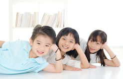 Asian kids. Lying on the floor and posing stock photos