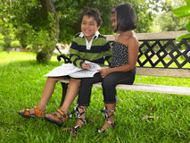 Asian kids in a park. With their colouring book Royalty Free Stock Image
