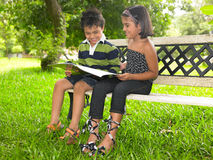 Asian kids in the park. Asian kids of indian origin in the park Royalty Free Stock Photo