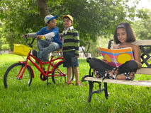 Asian kids playing in the park. Asian indian origin kids playing in the park royalty free stock images