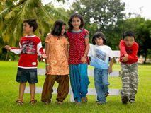 Asian kids playing in the park. Asian origin kids playing in the park Royalty Free Stock Images