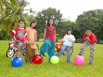 Asian kids playing in the park. Asian origin kids playing in the park Royalty Free Stock Photos