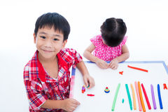 Asian kids playing with play clay on table. Strengthen the imagi Royalty Free Stock Photography