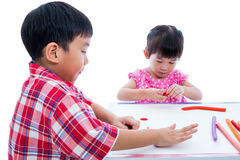 Asian kids playing with play clay on table. Strengthen the imagi Royalty Free Stock Images