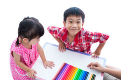 Asian kids prepare create toys from play clay. Strengthen the im Stock Images