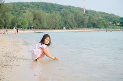 Asian kids Thai girl playing on the beach Summer vacation. Asian kids Thai girl playing on the beach - Summer vacation Royalty Free Stock Photo