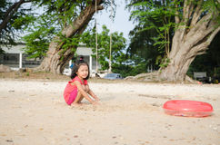 Asian kids Thai girl playing on the beach Summer vacation. Asian kids Thai girl playing on the beach - Summer vacation Stock Images