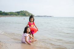 Asian kids Thai girl playing on the beach Summer vacation Royalty Free Stock Photo