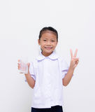 Asian kids - Thai student eat milk on white background Stock Images