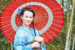 Asian kimono woman with bamboo grove Royalty Free Stock Photography