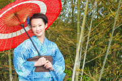 Asian kimono woman with bamboo grove Royalty Free Stock Image