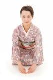 Asian kimono woman bow Royalty Free Stock Image