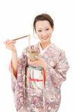 Asian kimono woman with Japanese buckwheat noodles Royalty Free Stock Photo