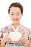 Asian kimono woman with rice Stock Images