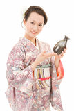 Asian kimono woman with sake bottle Stock Photos