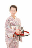 Asian kimono woman with sake bottle Royalty Free Stock Photography