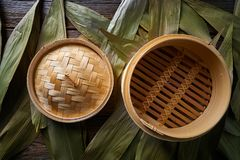 Asian kitchen bamboo steamer for steam cooking. Recipes on leafs Stock Photo