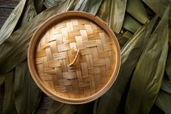 Asian kitchen bamboo steamer for steam cooking. Recipes on leafs Royalty Free Stock Images