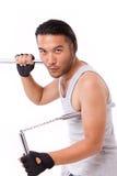 Asian Kung Fu man with chainsticks or nunchaku Royalty Free Stock Photo