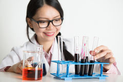 Asian lab people doing liquid sample analysis Stock Photography