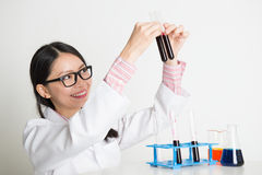 Asian lab worker doing liquid sample analysis Stock Photos