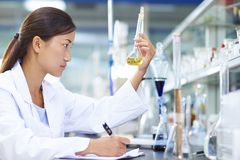 Asian Laboratory scientist working at lab with test tubes. One Female Chinese Laboratory scientist working at lab with test tubes Stock Photos