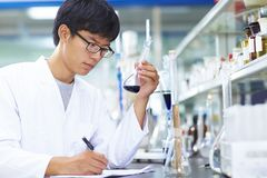 Asian Laboratory scientist working at lab with test tubes. One male Chinese Laboratory scientist working at lab with test tubes Stock Photos
