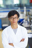Asian Laboratory scientist working at lab with test tubes Stock Image