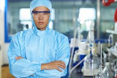 Asian Laboratory scientist working at lab with test tubes. One male Chinese Laboratory scientist working at lab with test tubes Stock Photography