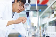 Asian Laboratory scientist working at lab with test tubes. One male Chinese Laboratory scientist working at lab with test tubes Royalty Free Stock Image